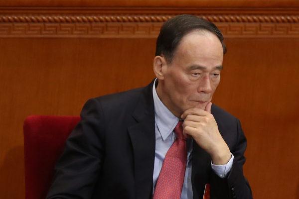 Yolsuzlukla Mücadele Bürosu Şefi Wang Qishan 5 Mart 2014 tarihinde Pekin'de Büyük Halk Salonu'nda.