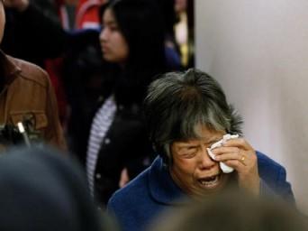 Çin'de Malezya Havayolu Uçağı Kurbanlarının Yakınları Mağdur