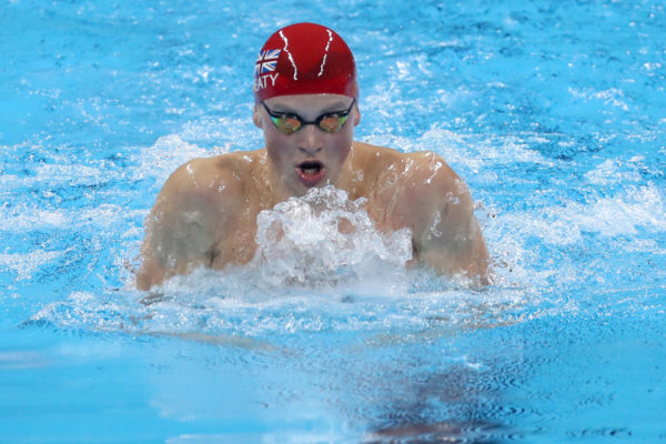 epa05459852 Adam Peaty of Great Britain competes in the Men's 100m Breaststroke Heats of the Rio 2016 Olympic Games Swimming events at Olympic Aquatics Stadium at the Olympic Park in Rio de Janeiro, Brazil, 06 August 2016.  EPA/ESTEBAN BIBA